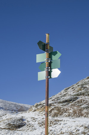 directional: Blank green directional signs in snow mountain Stock Photo
