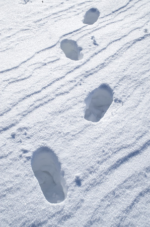 dint: Deep steps on snow bright surface in sunny day Stock Photo