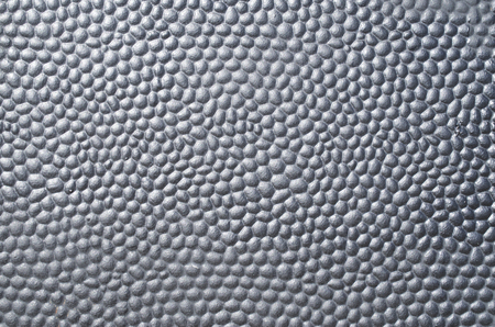 bumpy: Black metal plate with bumpy surface closeup Stock Photo
