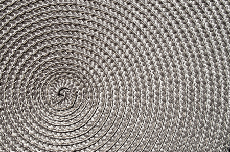 rattan mat: Grey rattan woven mat closeup in sunny day