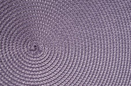 rattan mat: Violet rattan woven mat closeup in sunny day Stock Photo