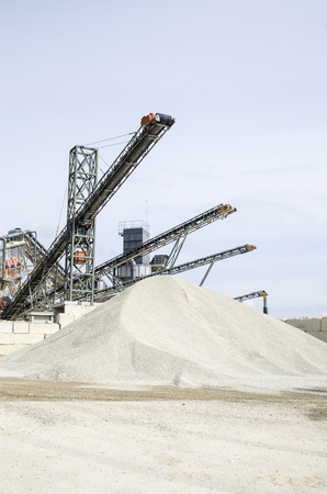 classifier: Several belt conveyors in Gravel Quarry  in cloudy day Stock Photo