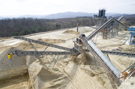 classifier: Two  belt conveyors in Gravel Quarry  in cloudy day