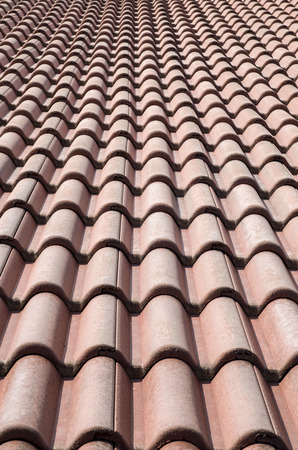 New roof with ceramic tiles in sunny day