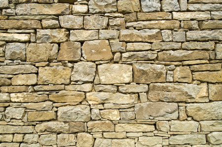 mastery: Old stone wall closeup  in sunny day