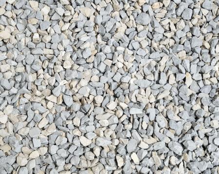 ecru: Gray and ecru rubble closeup in sunny day Stock Photo