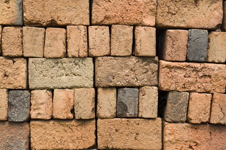 sone: A stack of colorful old clay bricks in rows