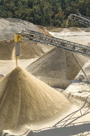 classifier: Working belt conveyors and a piles of rubble and stone meal in Gravel Quarry    Stock Photo