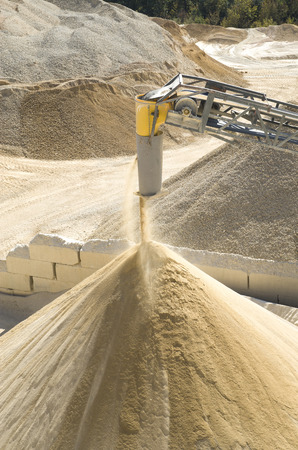 classifier: Working belt conveyor and a piles of stone meal in Gravel Quarry