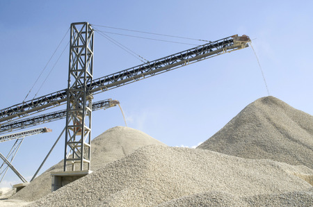 classifier: Several working belt conveyors and a piles of rubble in Gravel Quarry