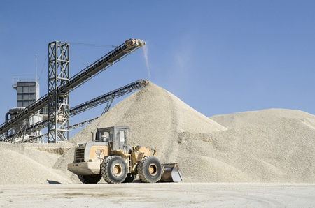 classifier: Several working belt conveyors and a piles of rubble in Gravel Quarry    Stock Photo