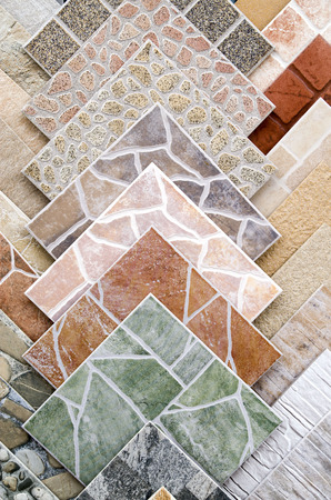 Samples of a colorful ceramic tile closeup in shop  Imagens