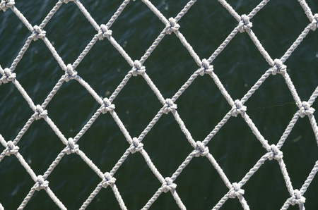 rope barrier: Safety net of a sailing ship closeup  Stock Photo