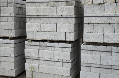 masonary: Several pallets of gray concrete blocks closeup