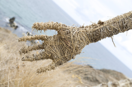 Hand made from straw and natural  rope on background of beach