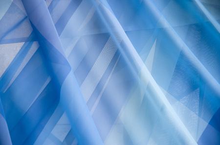 sateen: Thin transparent blue seal curtains closeup