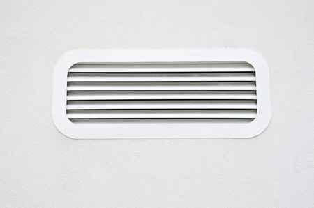 New white air conditioning vent on wall closeup Stock Photo