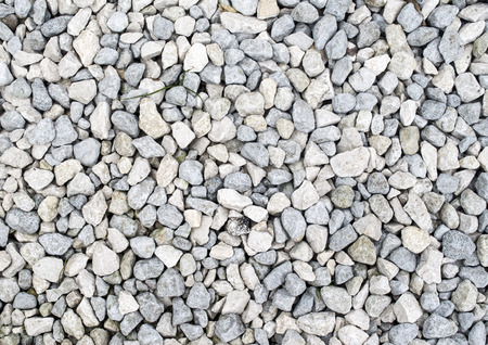 White and gray gravel closeup in sunny day