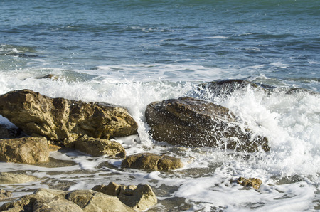 Foam and drops of breaking sea waves in sunny day, Black Sea  Stock Photo