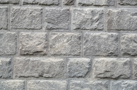 New wall of gray stone closeup