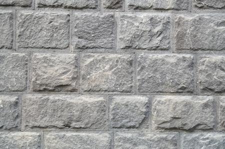 Nieuwe muur van grijze steenclose-up Stockfoto