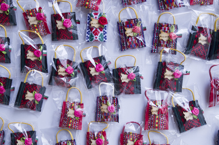 A small colorful woven souvenir bags with rose, Bulgaria, Europe