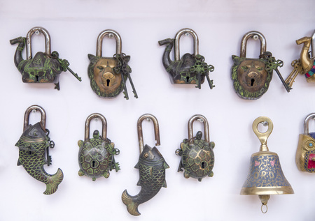 Old metal padlocks with shape of animals, Petra, Jordan