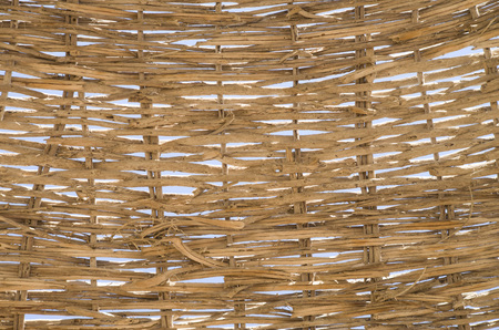 Ecru woven rattan closeup in the sky