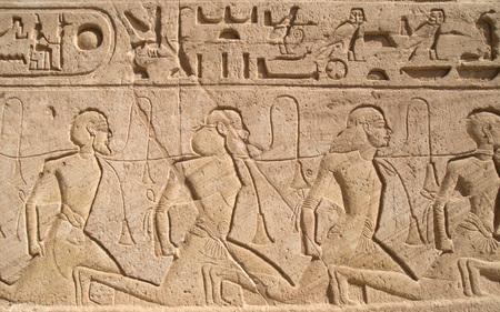 Relief depicting a row of captives in the Abu Simbel temple of Ramesses II, Egypt Standard-Bild
