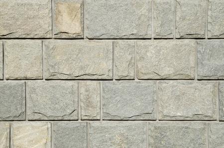 Sliced gneiss cladding slabs on wall closeup