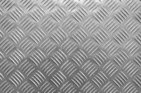 Decorative metal surface with ornaments closeup in black and white Reklamní fotografie - 120945105