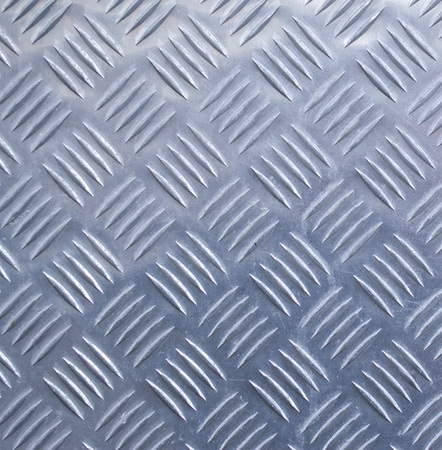 Decorative metal surface with ornaments closeup