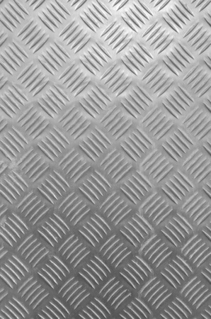 Decorative metal surface with ornaments closeup in black and white  Reklamní fotografie
