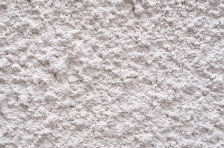New light pink external plaster on wall closeup