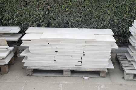 Wooden pallets with polished limestone for cladding