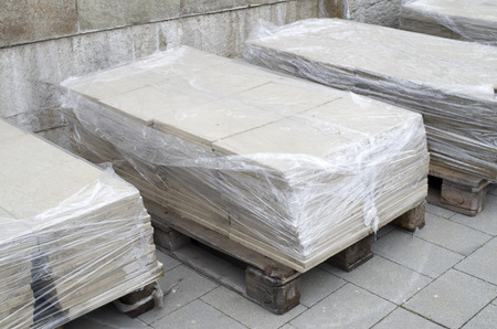 Wooden pallets with packed polished limestone for cladding