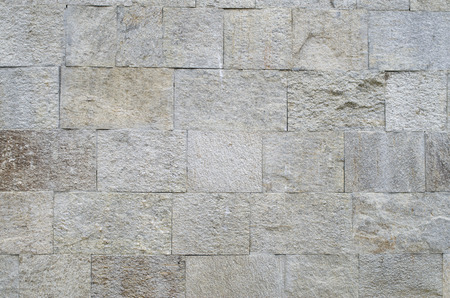 New polished sliced stone cladding on wall closeup