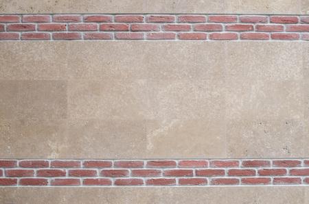 New polished sliced stone cladding and decorative red bricks on wall closeup  Reklamní fotografie