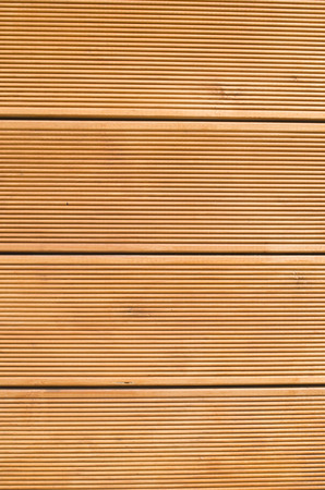 New orange wooden wall closeup
