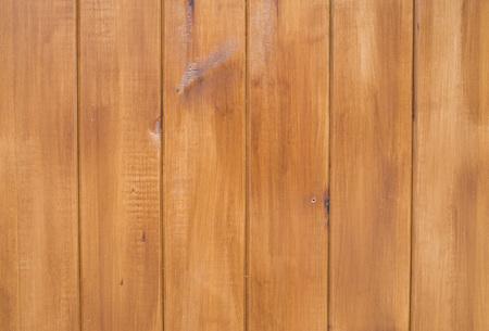 New varnished orange wooden wall closeup Reklamní fotografie
