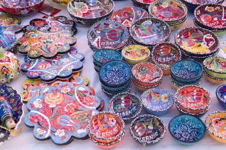 Colorful handmade painted bowls and plates wtih floral ornaments in Albania, Europe Reklamní fotografie