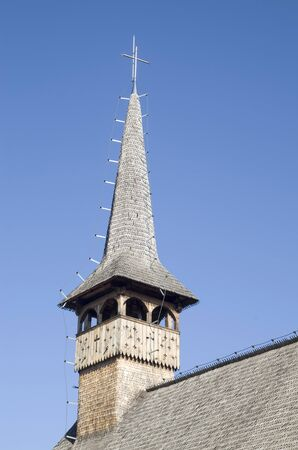 Belfry of wooden orthodox church of St. Basil the Great in Curtea de Arges, Romania, Europe