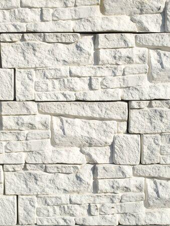Wall cladding imitating white stone closeup Stock Photo