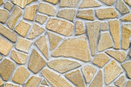 New colorful stone wall  closeup in sunny day
