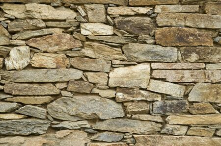 Old colorful stone wall  closeup in sunny day