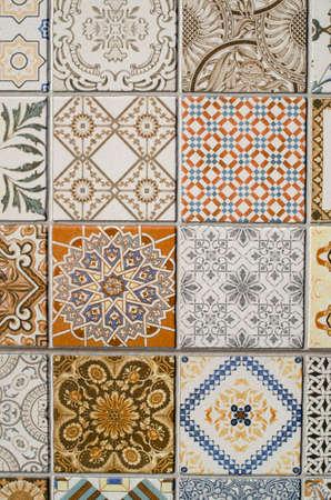 Imitation of colorful ceramic tiles on wall closeup