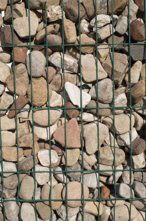 Metal mesh with stones close up