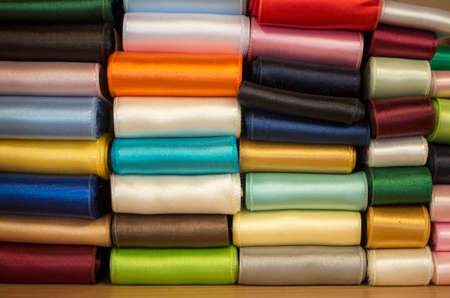 Many new color shiny arranged fabric ribbons closeup
