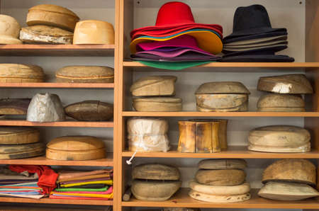 Wooden hat blocks for felt hats and felt hats in a hat workshop