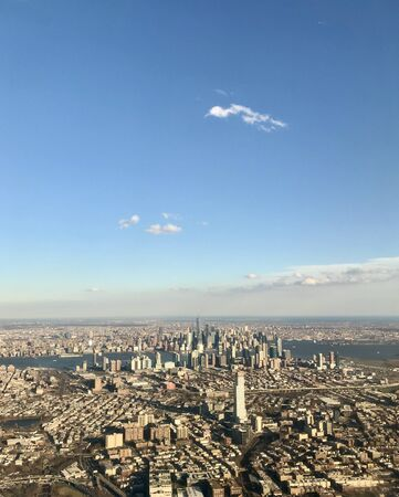 Aerial photography of panoramic birds eye view of the Manhattan island skyline of New York City with its highrise skyscraper buildings, infrastructure & landmarks from Newark, North Jersey Stok Fotoğraf